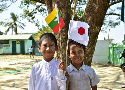 Myanmar Children Holding Japan Flag